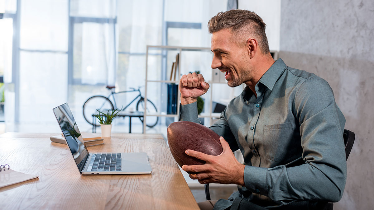 Calling an Audible: Agile Business Strategies for Long-Term Success. Man with a ball at the computer