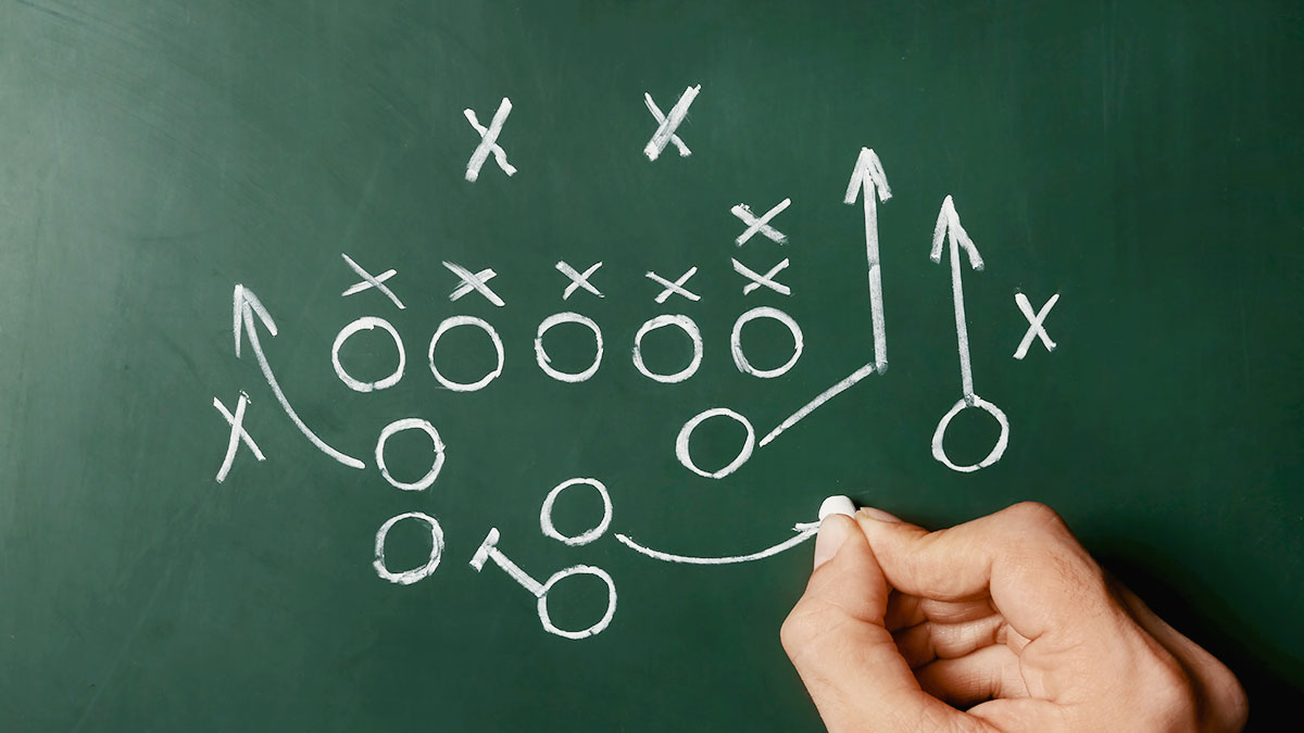 Restructuring business decisions and making frequent changes that adapt to current needs. X's and O's playbook play.